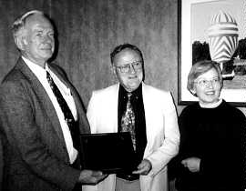 Bill McIntyre (center) receiving the Marye Award from Tyler Bastian  and Louise Akerson